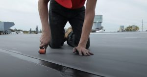 Coquitlam Roofer with mini roller applicator