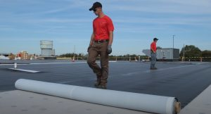 roofers doing Protective Flat Roof Layer