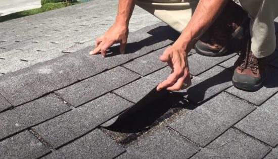 Coquitlam Roofers inspector doing roof analysis